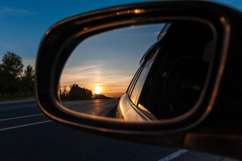 beautiful sunset in the mirror of the car